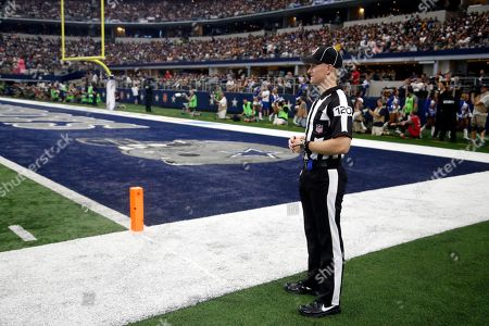 Side judge Jonah Monroe (120) stands watching play between the Green Bay Packers and Dallas Cowboys in an NFL football game, in Arlington, Texas