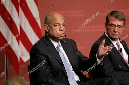 """Former Secretary of the Department of Homeland Security Jeh Johnson takes questions from an audience, as Harvard professor Ash Carter, former U.S. secretary of defense, right, looks, at a forum called """"Perspectives on National Security,"""" at the John F. Kennedy School of Government, on the campus of Harvard University, in Cambridge, Mass"""