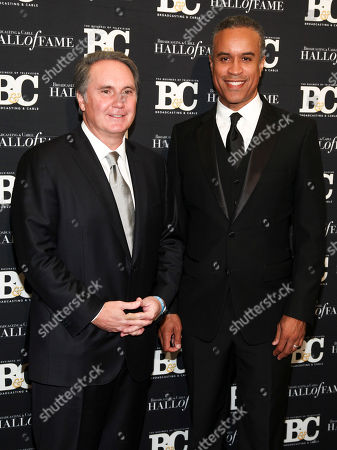 Peter Dunn, Maurice DuBois. Peter Dunn, left, and Maurice DuBois, right, pose in the press room at the Broadcasting & Cable Hall of Fame Awards 27th Anniversary Gala at the Grand Hyatt New York, in New York