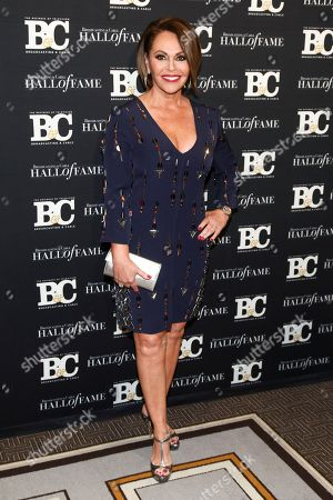 Maria Elena Salinas poses in the press room at the Broadcasting & Cable Hall of Fame Awards 27th Anniversary Gala at the Grand Hyatt New York, in New York