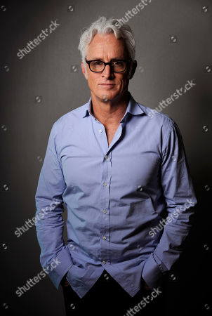 "Actor/director John Slattery poses for a portrait on Thursday, May 1, 2014 in Los Angeles. The ""Mad Men"" actor Slattery makes his directorial debut with ""God's Pocket,"" a independent film based on Peter Dexter's novel about overlapping working class lives, releasing in theaters on Friday, May 9. It's also one of the final performances by the late Philip Seymour Hoffman"