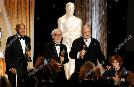 CORRECTS LEFT TO RIGHT IDENTITIES - Left to right, actor/singer/activist Harry Belafonte, Japanese animator/director Hayao Miyazaki, French screenwriter Jean-Claude Carriere and actress Maureen O'Hara pose together onstage with their Honorary Oscars during the 2014 Governors Awards, in Los Angeles