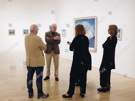 "In this Wed., Oct. 7, 2015, photo, Steve Martin, second from left, conducts an exhibition walk through along with co-curators, Andrew Hunter, left, Cynthia Burlingham, center, and Ann Philbin, Director of The Hammer Museum, for the exhibition ""The Idea of North: The Paintings of Lawren Harris,"" at The Hammer Museum in in Los Angeles. The show opens"