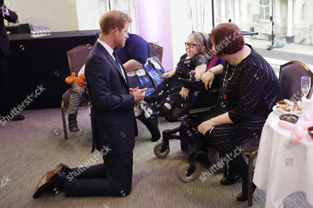 Prince Harry meets Katie Ward, aged 10, the winner of the Inspirational Child Award aged 7-10, with her mother Ruth during a pre-ceremony category winners reception