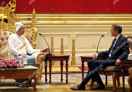 Kristian Schmidt, Htin Kyaw. Myanmar's President Htin Kyaw, left, talks with European Union's ambassador to Myanmar Kristian Schmidt, right, while presenting his credentials at the President House in Naypyitaw, Myanmar