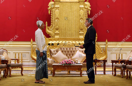 Myanmar's President Htin Kyaw, left, accepts the credentials from European Union's ambassador to Myanmar Kristian Schmidt, at the Presidentital House in Naypyitaw, Myanmar