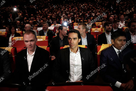 Britain's Chris Froome, left, Spain's Alberto Contador, center, and Colombia's Nairo Quintana attend the presentation of the 2018 Tour de France cycling race, in Paris, . The 105th edition of the race starts on July 7 2018 to end on the Champs-Elysees avenue on July 29