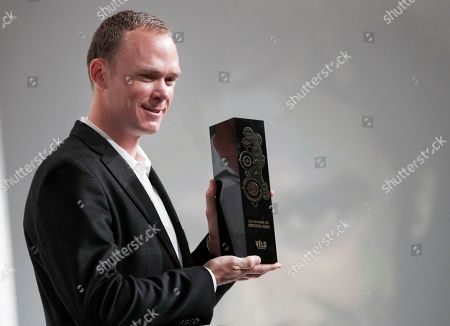 Britain's Chris Froome, centre, poses with his Velo d'Or award during the presentation of the 2018 Tour de France cycling race, in Paris, . The 105th edition of the race starts on July 7 2018 to end on the Champs-Elysees avenue on July 29. French former cyclist Bernard Hinault stands at right