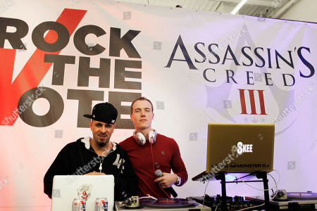DJ Tony Touch and DJ Skee attend the one-night show of Assassin's Creed III 'Art of the Assassin'? exhibit at The Hole in New York City on . Select pieces will be auctioned off at the end of the month to raise money for Rock the Vote