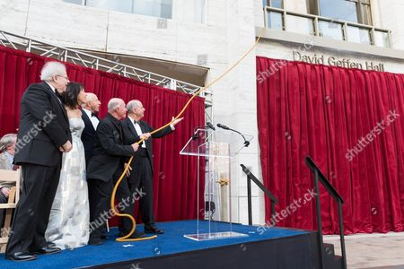 Pianist Emanuel Ax, Lincoln Center Chair Katherine Farley, New York Philharmonic Chair Oscar Schafer, David Geffen, Lincoln Center President Jed Bernstein, pulls the rope at the Renaming Ceremony for David Geffen Hall, on in New York