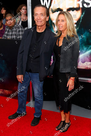 "G. E. Smith, left, and Taylor Barton, right, attend the premiere of ""Roger Waters The Wall"" at the Ziegfeld Theatre, in New York"