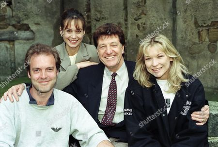 Ep 2208 Thursday 22nd May 1997 Cast stills of Frank Tate, as played by Norman Bowler ; Kim Tate, as played by Claire King ; Zoe Tate, as played by Leah Bracknell ; Chris Tate, as played by Peter Amory ; celebrating Norman Bowler's final episode in Emmerdale.