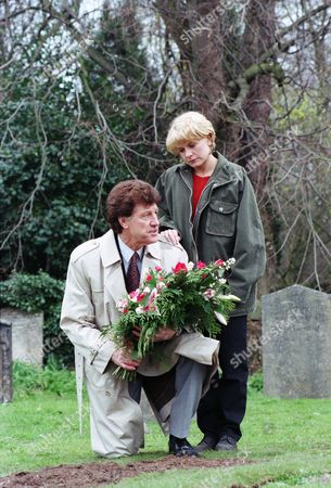 Ep 2207 Wednesday 21st May 1997  Thanking Frank for getting Chris to sign deeds of Mill Cottage over to her, Rachel accompanies Frank as he puts flowers on Kim's grave - With Frank Tate, as played by Norman Bowler ; Rachel Hughes, as played by Glenda McKay.