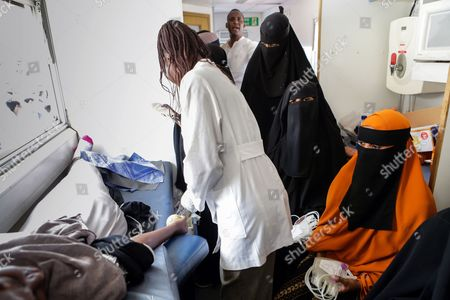 Somali women (R) look on holding blood bags as they wait to give blood inside a blood donation truck during a blood donation event for the victims of the Mogadishu attack in the Somali neighbourhood Eastleigh in the Kenyan capital Nairobi, Kenya, 17 October 2017. The death toll from the 14 October truck bomb attack in Mogadishu has risen to more than 300, one of the world's worst attacks in the recent history. Kenya's Foreign Minister Amina Mohamed sayd the country will evacuate 31 victims of the attack to Nairobi and the country will send 31 tonnes of medicines to Somalia.
