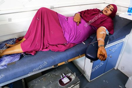 A Somali woman gives blood inside a blood donation truck during a blood donation event for the victims of the Mogadishu attack in the Somali neighbourhood Eastleigh in the Kenyan capital Nairobi, Kenya, 17 October 2017. The death toll from the 14 October truck bomb attack in Mogadishu has risen to more than 300, one of the world's worst attacks in the recent history. Kenya's Foreign Minister Amina Mohamed sayd the country will evacuate 31 victims of the attack to Nairobi and the country will send 31 tonnes of medicines to Somalia.