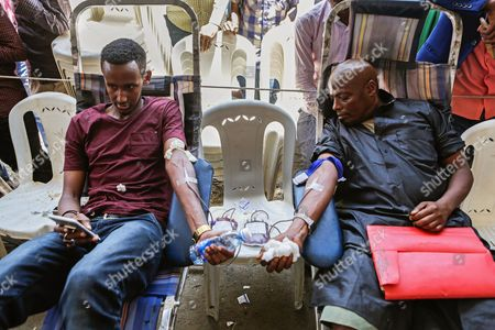 Somali men give blood during a blood donation event for the victims of the Mogadishu attack in the Somali neighbourhood Eastleigh in the Kenyan capital Nairobi, Kenya, 17 October 2017. The death toll from the 14 October truck bomb attack in Mogadishu has risen to more than 300, one of the world's worst attacks in the recent history. Kenya's Foreign Minister Amina Mohamed sayd the country will evacuate 31 victims of the attack to Nairobi and the country will send 31 tonnes of medicines to Somalia.