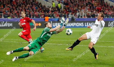 Spartak goalkeeper Aleksandr Selikhov, left saves from Sevilla's Michael Krohn-Dehli during the Champions League group E soccer match between Spartak Moscow and Sevilla at the Otkrytiye Arena in Moscow, Russia, Tuesday, Oct. 17,2017