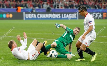 Spartak goalkeeper Aleksandr Selikhov, centre, reacts after saving a shot from Sevilla's Michael Krohn-Dehli, left, as Sevilla's Wissam Ben Yedder takes the ball past during the Champions League group E soccer match between Spartak Moscow and Sevilla at the Otkrytiye Arena in Moscow, Russia, Tuesday, Oct. 17,2017