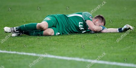 Spartak goalkeeper Aleksandr Selikhov lies injured after a collision with Sevilla's Michael Krohn-Dehli during the Champions League group E soccer match between Spartak Moscow and Sevilla at the Otkrytiye Arena in Moscow, Russia, Tuesday, Oct. 17,2017