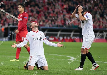 Nolito, Michael Krohn-Dehli. Sevilla's Nolito, right, and Sevilla's Michael Krohn-Dehli react after missing a chance during the Champions League Group E soccer match between Spartak Moscow and Sevilla in Moscow, Russia