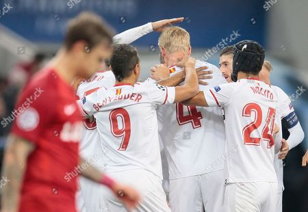 Nolito, Michael Krohn-Dehli. Sevilla's Simon Kjaer, centre, celebrates after scoring his sides first goal of the game during the Champions League Group E soccer match between Spartak Moscow and Sevilla in Moscow, Russia