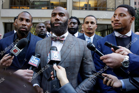 Eric Reid, Anquan Boldin, Malcolm Jenkins. Former NFL football player Anquan Boldin, left, Philadelphia Eagles Malcolm Jenkins, center, and San Francisco 49ers Eric Reid, right, speak to the press outside the league's headquarters after meetings, in New York