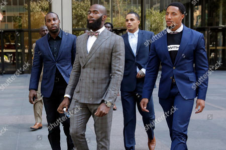 Eric Reid, Anquan Boldin, Malcolm Jenkins, Kenny Stills. Former NFL player Anquan Boldin, left, Philadelphia Eagles Malcolm Jenkins, second left, Miami Dolphins Kenny Stills, third left, and San Francisco 49ers Eric Reid, leave National Football League headquarters after meetings in New York