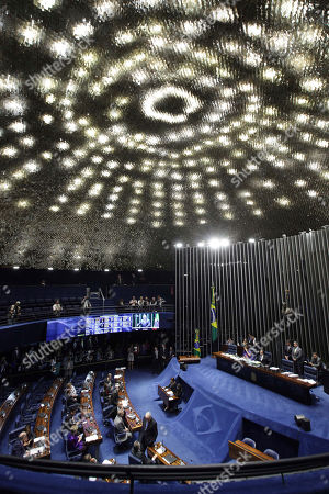 Lawmakers meet for a Senate session to decide whether or not to remove suspended Senator Aecio Neves in Brasilia, Brazil, . The Senate rejected the decision by the country's top court and returned Neves to office after he was accused of obstruction of justice in a corruption case