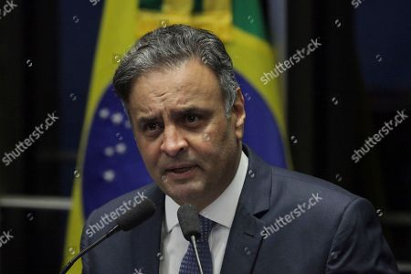 Senator Aecio Neves, of the Brazilian Social Democracy Party, makes his defense statement at the Senate in Brasilia, Brazil. On Tuesday, Oct. 17, the Senate rejected a decision by the country's top court and returned Neves to office after he was accused of obstruction of justice in a corruption case