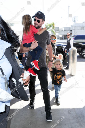Editorial image of Chris Hemsworth and Elsa Pataky at LAX International Airport, Los Angeles, USA - 17 Oct 2017