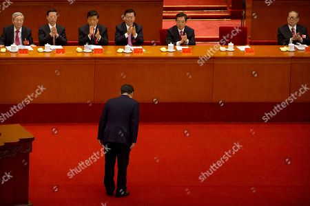 """Xi Jinping, Zhu Rongji, Zhang Gaoli, Liu Yunshan, Zhang Dejiang, Hu Jintao, Jiang Zemin. Chinese President Xi Jinping bows to current and former Chinese leaders, from left, former Premier Zhu Rongji, Politburo Standing Committee members Zhang Gaoli, Liu Yunshan, and Zhang Dejiang, former Chinese President Hu Jintao, and former Chinese President Jiang Zemin after giving a speech during the opening session of China's 19th Party Congress at the Great Hall of the People in Beijing, . Xi on Wednesday urged a reinvigorated Communist Party to take on a more forceful role in society and economic development to better address """"grim"""" challenges facing the country as he opened a twice-a-decade national congress"""