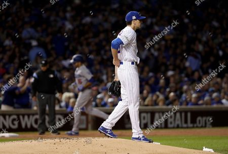Andre Ethier, Kyle Hendricks. Los Angeles Dodgers' Andre Ethier runs bases after hitting a home run as Chicago Cubs starting pitcher Kyle Hendricks reacts during the second inning of Game 3 of baseball's National League Championship Series, in Chicago