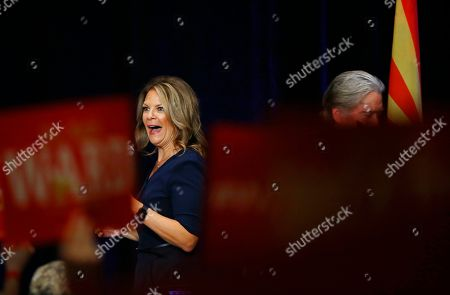 Steve Bannon, right, former strategist for President Donald Trump, exits the stage after introducing Arizona Senate candidate Kelli Ward, in Scottsdale, Ariz. Ward is running against incumbent Republican Jeff Flake in next year's GOP primary