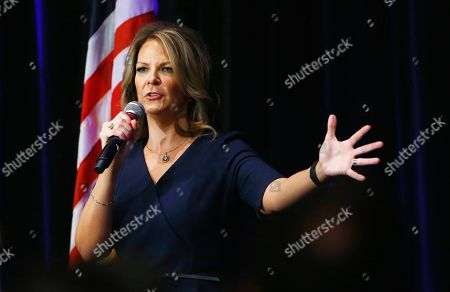 Arizona Senate candidate Kelli Ward speaks at a campaign rally, in Scottsdale, Ariz. Ward is running against incumbent Republican Jeff Flake in next year's GOP primary