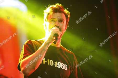 Stock Photo of Pau Dones, singer and leader of the Spanish band Jarabe de Palo performs during a concert at the Cariola Theater in Santiago de Chile, Chile, 17 October 2017. The concert is part of the '50 Palos' tour.