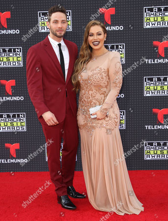 Stock Image of Gabriel Coronel, left, and Chiquis Rivera arrive at the Latin American Music Awards at the Dolby Theatre, in Los Angeles