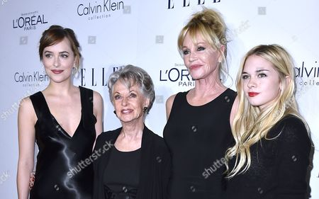 From left, Dakota Johnson, Tippi Hedren, Melanie Griffith and Stella Banderas attend the 2015 ELLE Women in Hollywood Awards at the Four Seasons Hotel, in Los Angeles