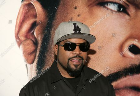 """Recording artist and actor Ice Cube attends a screening of """"Ride Along,"""" in New York. Legendary singer Aretha Franklin and Motown founder Berry Gordy will be honored at the 2014 BET Honors. The network announced Thursday, Jan. 16, 2014, that rapper-actor Ice Cube, American Express CEO Ken Chenault and photographer and video artist Carrie Mae Weems will also receive tributes at the event"""