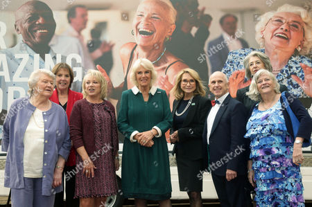 Stock Image of Camilla Duchess of Cornwall (centre) with (left to right) Dame Patricia Routledge, Dame Penelope Wilton, Elaine Paige, Felicity Kendal, Wayne Sleep, Ann Widdecombe, Maureen Lipman and Baroness Williams during a reception to celebrate the launch of the Royal Voluntary Service's 'Our Amazing People' campaign, at Clarence House