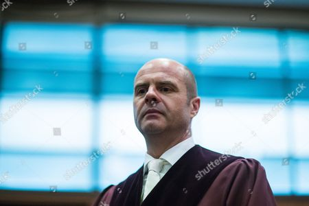 Lienhard Weiss, prosecuting attorney, looks on ahead of Daniel M.'s trial on charges of spying for the Swiss government in Frankfurt am Main, Germany, 18 October 2017. German authorities accuse Daniel M., a former policeman from Zurich, of having spied on German tax investigators who were seeking to buy CDs listing German citizens who were evading taxes by diverting their money through Swiss banks. Employees from several Swiss banks did sell German authorities such CDs, which led to the exposure of thousands of tax-evading Germans.