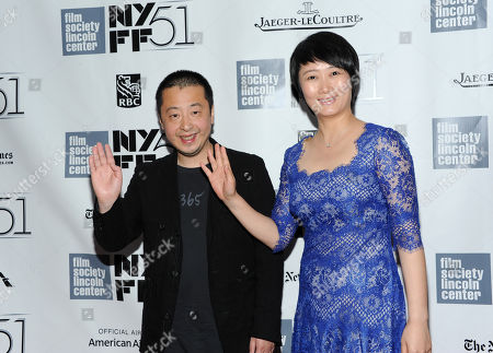 """Chinese director Zhangke Jia, left, and actress wife Tao Zhao attend a screening for """"Touch of Sin"""" during the 51st New York Film Festival on in New York"""