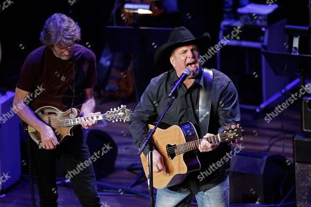 Stock Image of Garth Brooks and Sam Bush perform at the 54th Annual ASCAP Country Music Awards at the Ryman Auditorium, in Nashville, Tenn