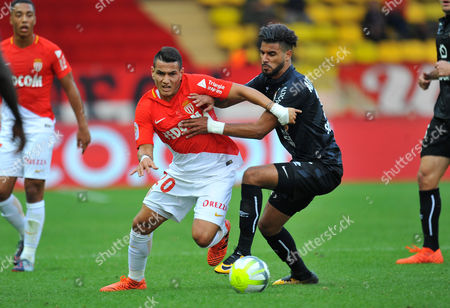 Monaco's Rony Lopez is held back by  Caen's Youssef Ait Bennasser