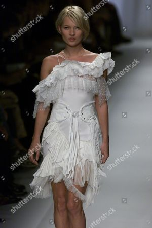 Kate Moss Wearing A Frilly Lacy Number Designed By Nicholas Ghesquiere In His Romantic Spring Collection For Balenciaga.