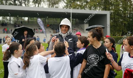 Israel Dagg (C), player of the New Zealand national rugby union team, signs autographs during a training session with children in Gijon, Asturias, northern Spain, 18 October 2017. The New Zealand national rugby union team  will receive the Princess of Asturias 2017 Sports award in a ceremony held on 20 October 2017.