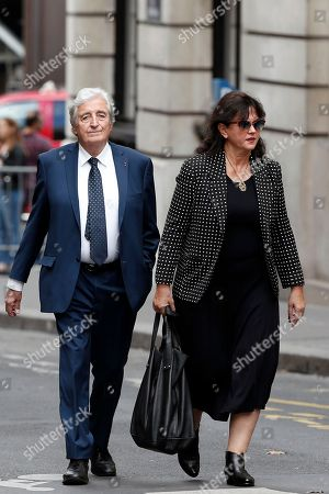 Scriptwriter Jean Loup Dabadie and his wife Véronique Bachet arrive to the funeral ceremony for French actor Jean Rochefort at the Saint Thomas d'Aquin church in Paris, . French actor Jean Rochefort, who starred in more than 100 movies over a half-century and was much loved by the French public, has died. He was 87