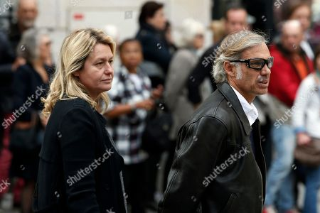 French actor Paul Belmondo and his wife Luana arrive to the funeral ceremony for French actor Jean Rochefort at the Saint Thomas d'Aquin church in Paris, . French actor Jean Rochefort, who starred in more than 100 movies over a half-century and was much loved by the French public, has died. He was 87