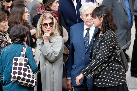 Director Nicole Garcia, center left, and scriptwriter, Jean Loup Dabadie, center right, leave the funeral ceremony for French actor Jean Rochefort at the Saint Thomas d'Aquin church in Paris, . French actor Jean Rochefort, who starred in more than 100 movies over a half-century and was much loved by the French public, has died. He was 87