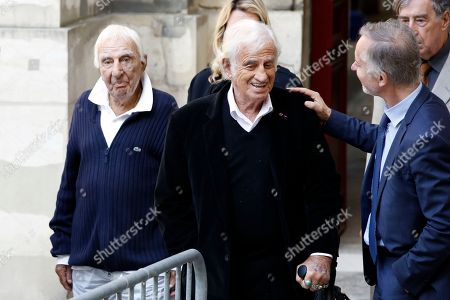 French actors Jean Paul Belmondo, center, and Charles Gerard, left, leave the funeral ceremony for French actor Jean Rochefort at the Saint Thomas d'Aquin church in Paris, . French actor Jean Rochefort, who starred in more than 100 movies over a half-century and was much loved by the French public, has died. He was 87