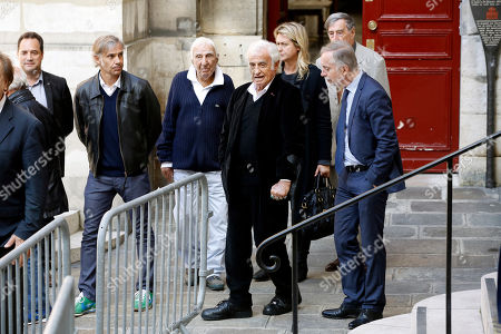 French actor Jean Paul Belmondo, center, his son Paul, left, his daughter in law Luana, center background, and actor Charles Gerard, leave the funeral ceremony for French actor Jean Rochefort at the Saint Thomas d'Aquin church in Paris, . French actor Jean Rochefort, who starred in more than 100 movies over a half-century and was much loved by the French public, has died. He was 87